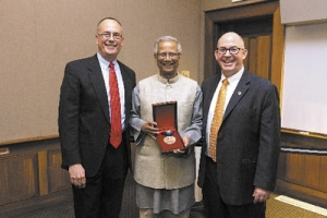 Nobel Peace Prize winner Muhammad Yunus, Mark Thompson, senior vice president for academic and student affairs, Matt O'Connor, dean of the School of Business
