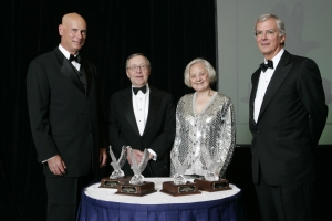 Kenneth T. Neilson, Edward Netter, Muriel Siebert and William G. Spears smile at the Quinnipiac University Business Leader Hall of Fame ceremony.