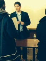 One of the panelists, QU Alumni Conor Murphy, sharing his business card with a student.