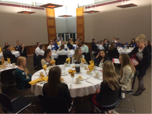 Undergraduate business students attend an Etiquette Dinner sponsored by Career Development.