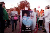 5-year-old Kendall Pallone trick-or-treats through crowd of more than 200 supporters on the QU Quad